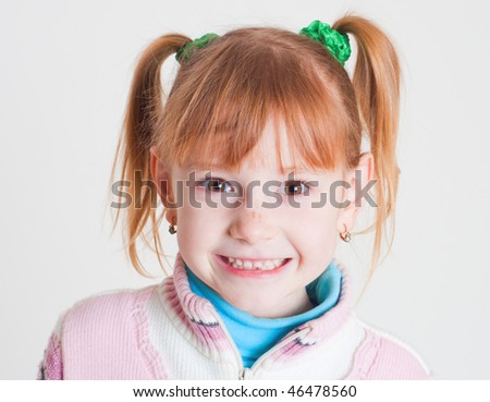 smiling little girl with milk teeth - stock photo