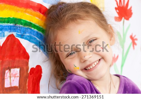 smiling little girl with painting - stock photo