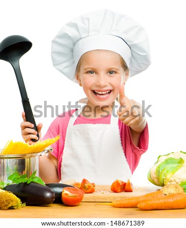 smiling little girl with spaghetti and vegetables over white