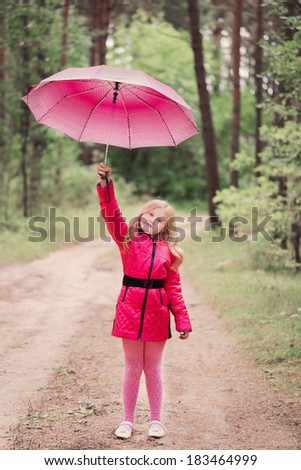 smiling little girl with umbrella - stock photo