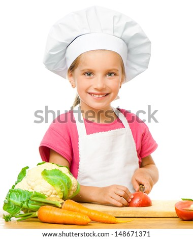 smiling little girl with vegetables on a white background