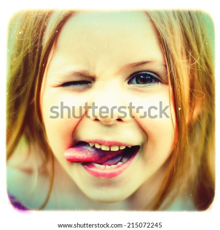Smiling little girl with vintage effect - stock photo