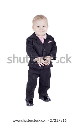 smiling little man in classic suit over white background