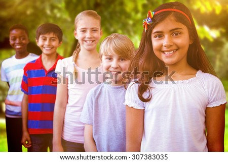 Smiling little school kids in school corridor against trees and meadow in the park - stock photo