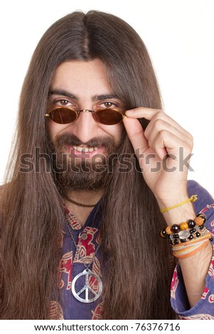 Smiling long-haired hippie man in a glasses - stock photo