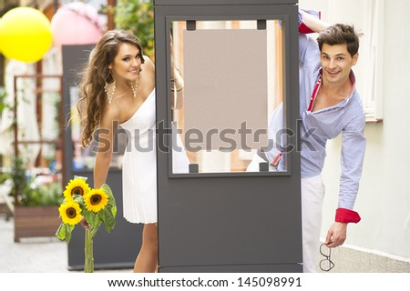 Smiling lovely couple with board - stock photo
