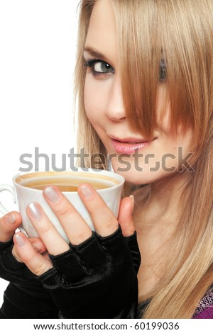 Smiling lovely young blonde with a cup of tea