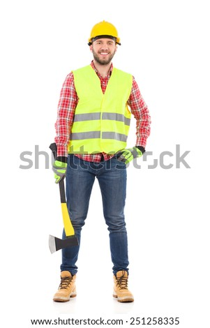 Smiling lumberjack in yellow helmet and lime waistcoat posing with an axe. Full length studio shot isolated on white.