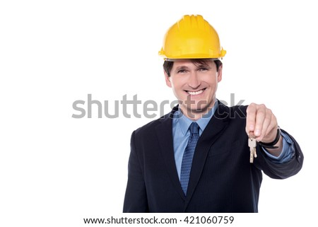 Smiling Male architect offering a new house key