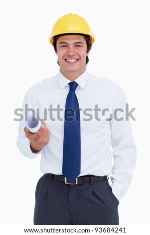 Smiling male architect with helmet and plans against a white background
