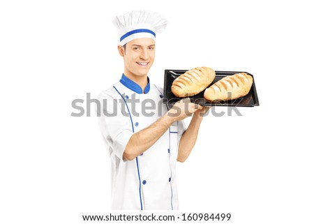 Smiling male baker holding freshly baked breads isolated on white background