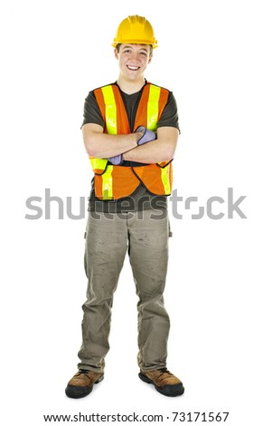 Smiling male construction worker in safety vest and hard hat - stock photo