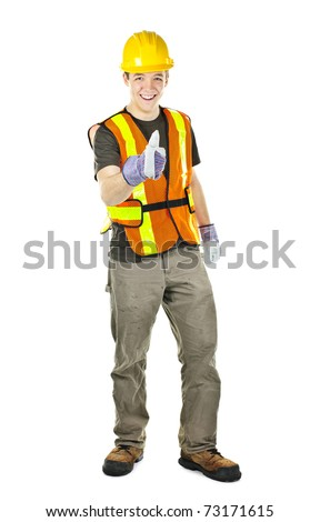 Smiling male construction worker showing thumbs up in safety vest and hard hat - stock photo