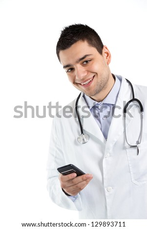 Smiling male doctor holding a cell phone.