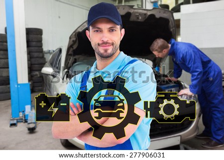Smiling male handyman in coveralls standing arms crossed against mechanic examining car engine - stock photo