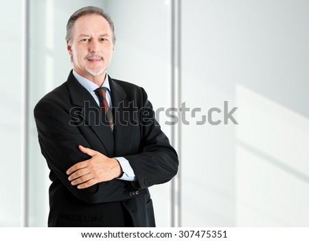 Smiling male manager in his office - stock photo