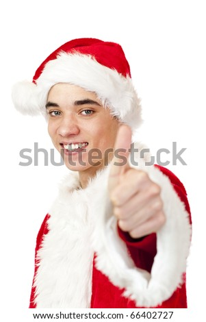 Smiling male santa claus teenager shows thumb up. Isolated on white background.