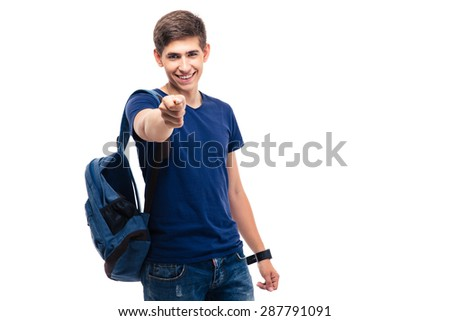 Smiling male student pointing at camera isolated on a white background - stock photo