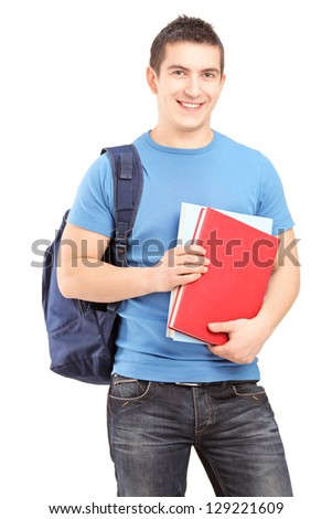 Smiling male student with backpack holding books isolated against white background - stock photo