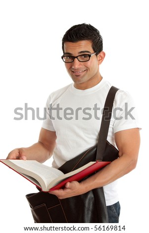 Smiling male university or college student, holding an open textbook.  White background. - stock photo