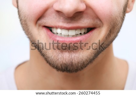 Smiling man after visit dentist close up - stock photo