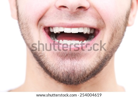 Smiling man after visit dentist isolated on white - stock photo