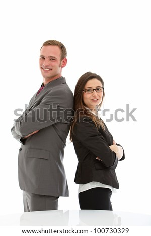 Smiling man and woman in suits standing back to back on white background