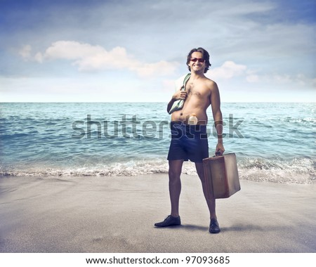 Smiling Man at the Seaside - stock photo