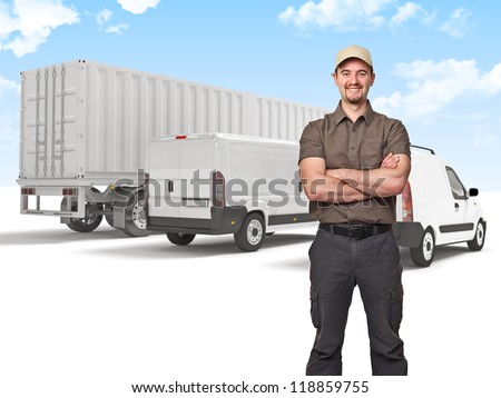 smiling man crossed arms and truck background - stock photo