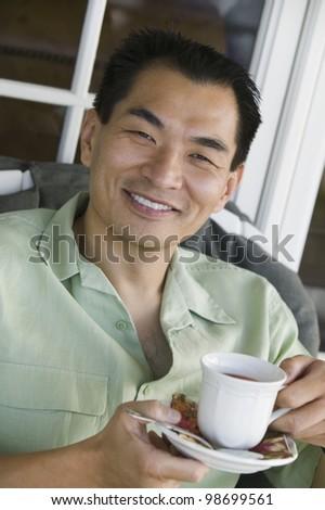 Smiling Man Drinking Coffee - stock photo
