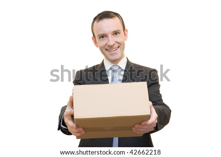 Smiling man giving a brown cardboard box - stock photo