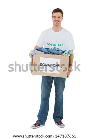 Smiling man holding donation box on white background - stock photo