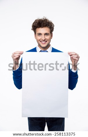 Smiling man holding empty paper and looking at camera - stock photo