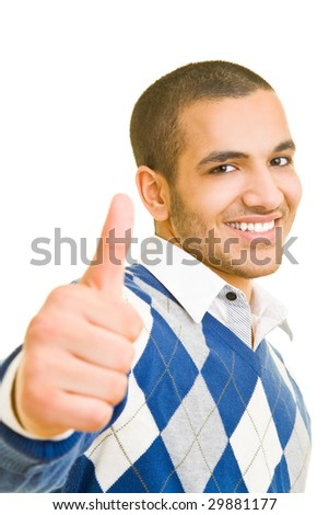 Smiling man holding his thumb up - stock photo