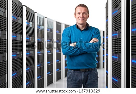 smiling man in data center - stock photo