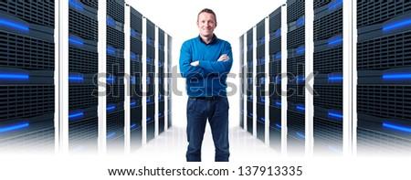 smiling man in data center - stock photo