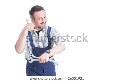 Smiling man in overalls making a call me gesture with copy space isolated on white background - stock photo