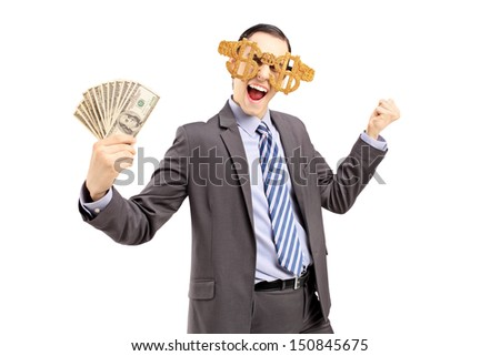 Smiling man in suit wearing dollar sign glasses and holding US dollars isolated on white background - stock photo