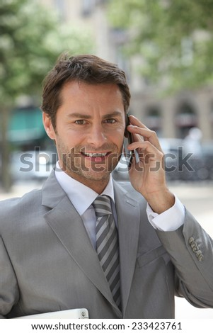 Smiling man on phone - stock photo