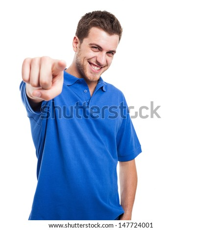 Smiling man pointing his finger to you - stock photo