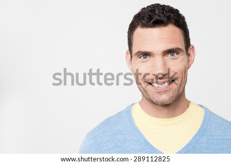 Smiling man posing over grey background