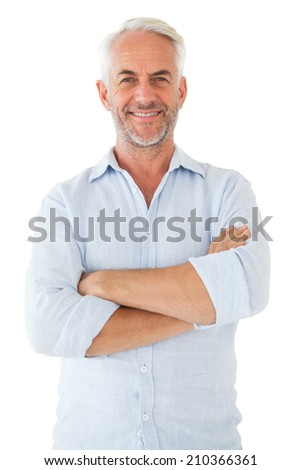 Smiling man posing with arms crossed on white background - stock photo