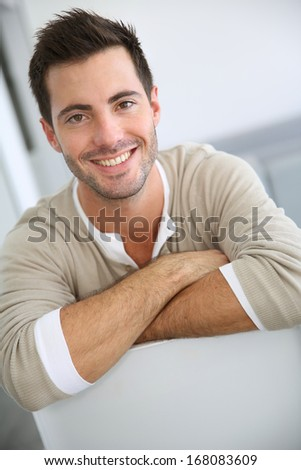 Smiling man relaxing at home - stock photo