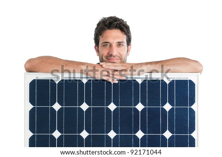 Smiling man showing and holding a solar panel isolated on white background - stock photo