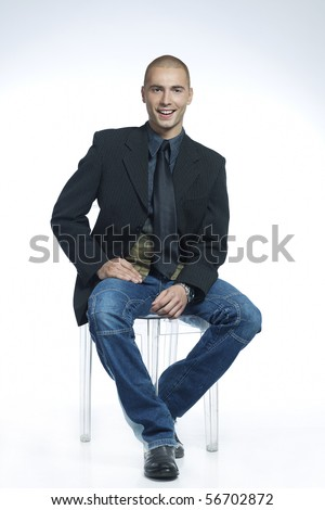 smiling man sitting in a chair - stock photo