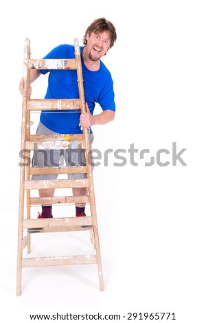 Smiling man standing on a ladder isolated on a white background