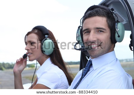 Smiling man waiting for takeoff in the cockpit of a light aircraft - stock photo