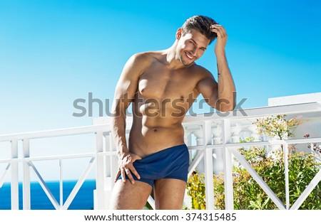 Smiling man wear swimming trunks  - stock photo
