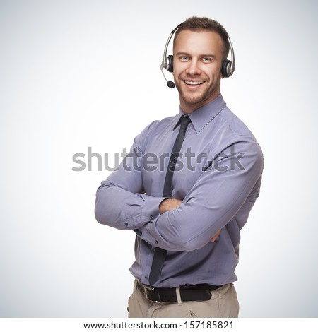 smiling man wearing a headset on blue gradient background - stock photo