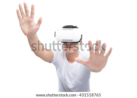Smiling man wearing VR goggles, isolated on white - stock photo